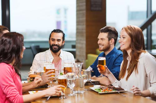 young-group-of-friends-enjoying-pasta-dinner